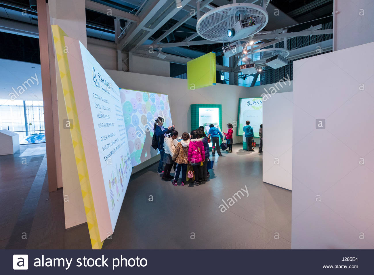 """""""Stories of One, Everyone, and You"""" exhibit at the Miraikan - Museum of Emerging Science and Innovation, where visitors - Stock Image"""