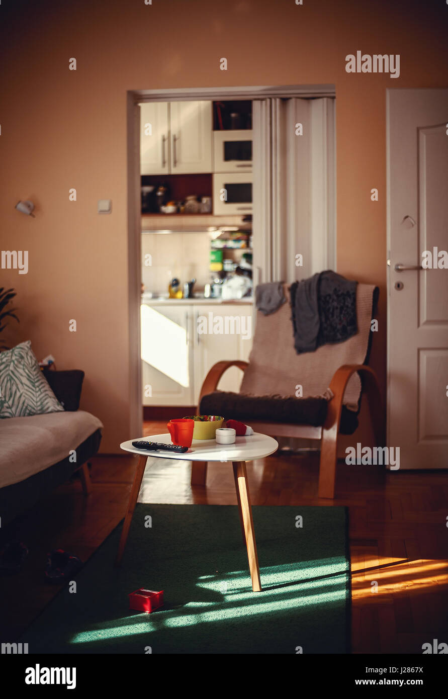 One ordinary home room, interior details during sunny day. - Stock Image