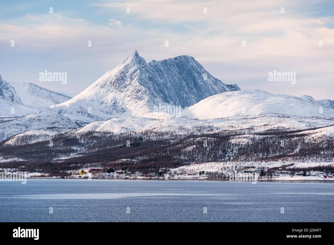Distinctive mountain on the island of Senja, Troms County, northern Norway, seen from a Hurtigruten Coastal Express - Stock Image