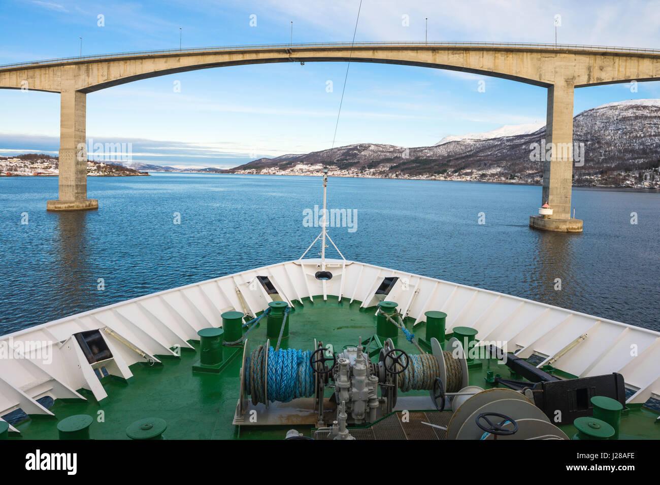 Hurtigruten Coastal Express cruise ship 'Nordnorge' approaches the Gisund bridge to Senja Island at Finnsnes, - Stock Image