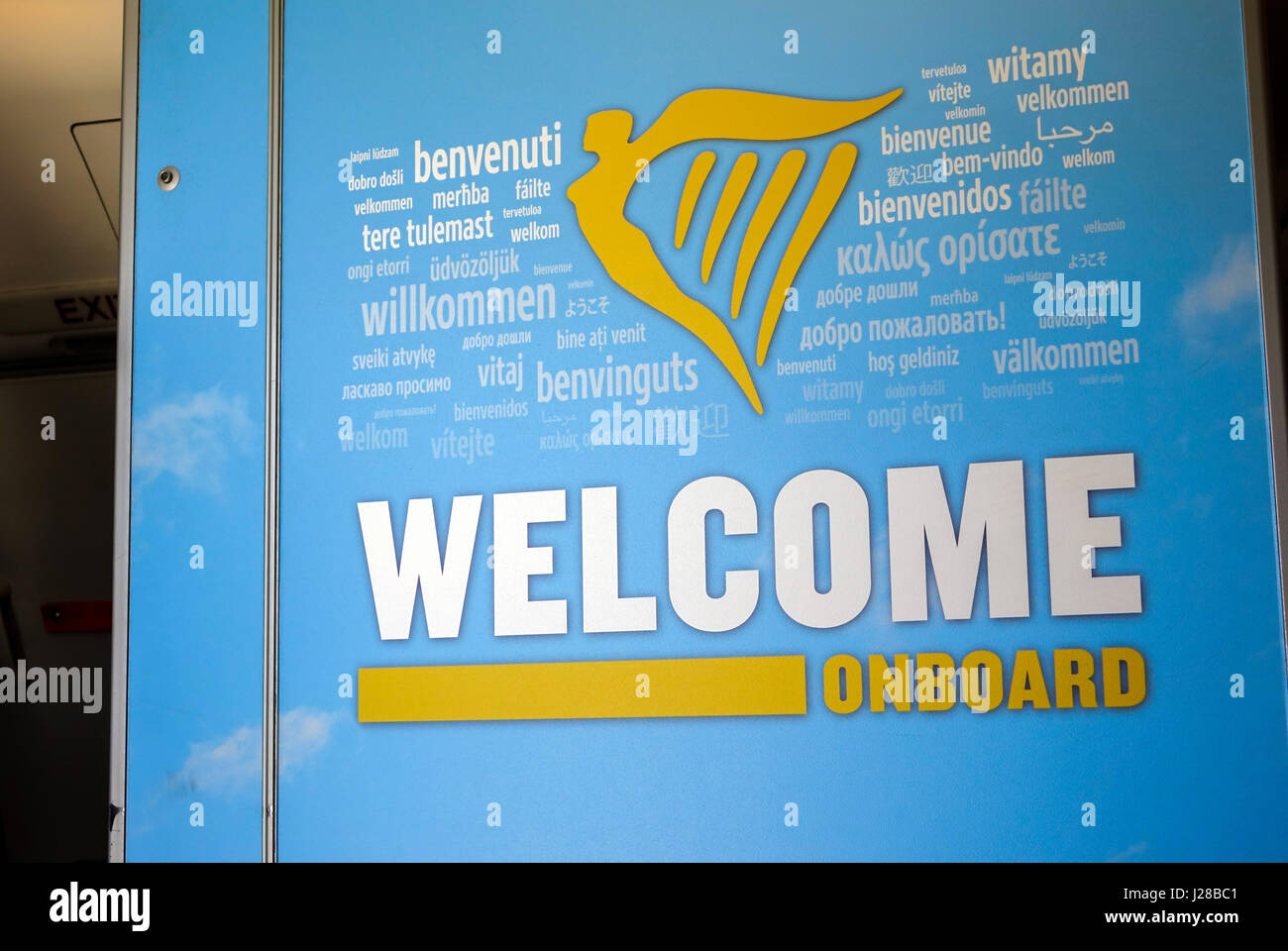 Welcome on board sign in many languages, Ryanair Beoing 737 - Stock Image