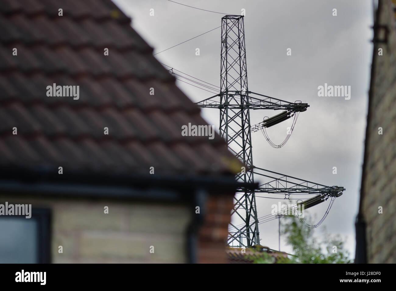 Electricity Pylon Cables Near House Stock Photos & Electricity Pylon ...