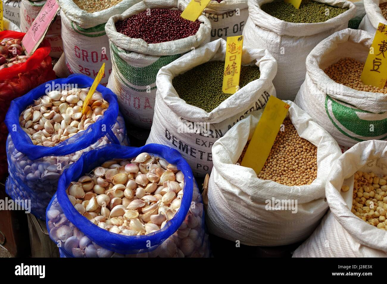 KAOHSIUNG, TAIWAN -- MAY 31, 2014: A store at the famous Zongjie dry goods market sells beans, grains, nuts and - Stock Image