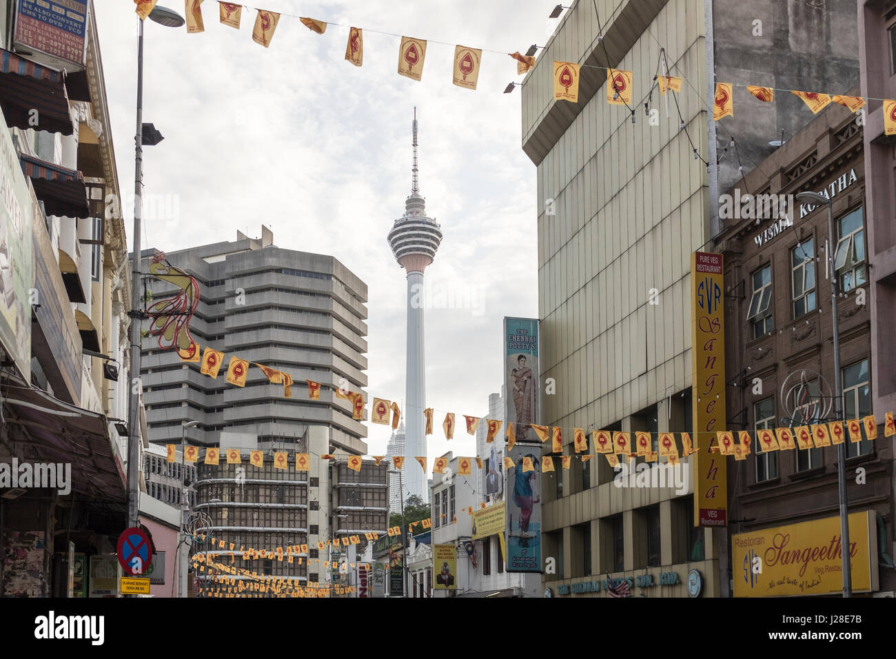 The KL Tower is seen through the buildings in downtown Kuala Lumpur, Malaysia - Stock Image