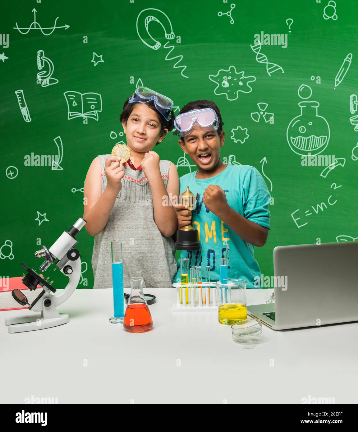 Cute Indian Kids Doing Science Experiment In Chemistry Lab