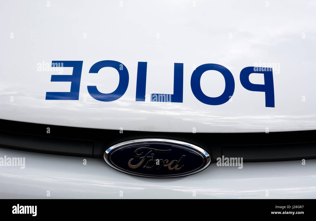 Reversed word on a police vehicle, UK - Stock Image