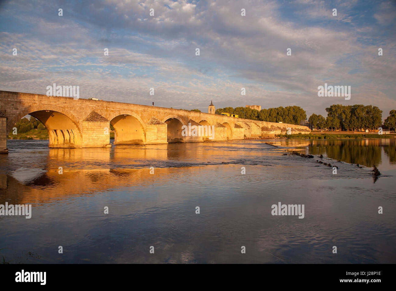 Stone arched bridge over the river Loire at Beaugency in the early morning sun. - Stock Image