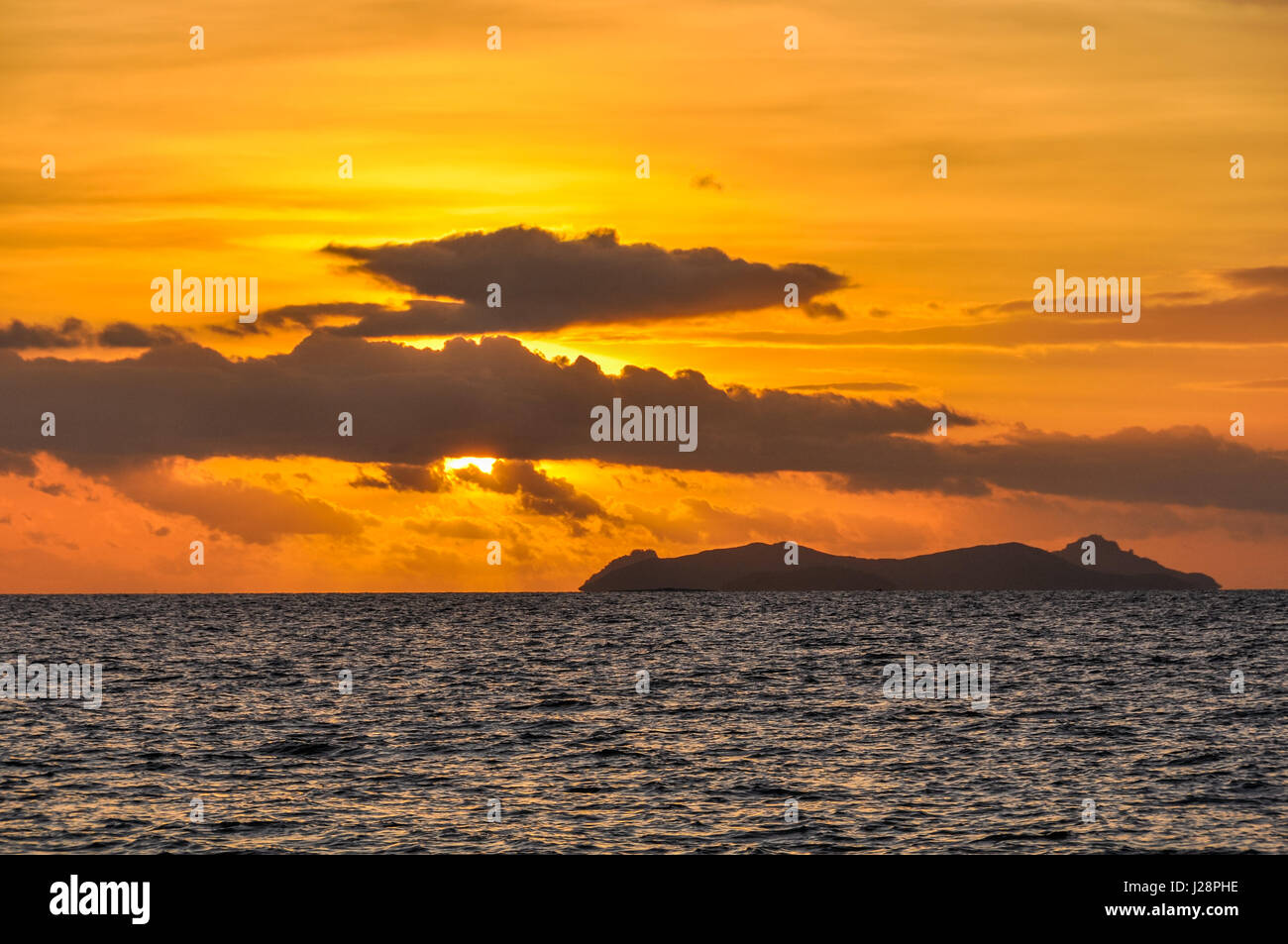 Intense colors at sunset on Bounty Island in Fiji - Stock Image