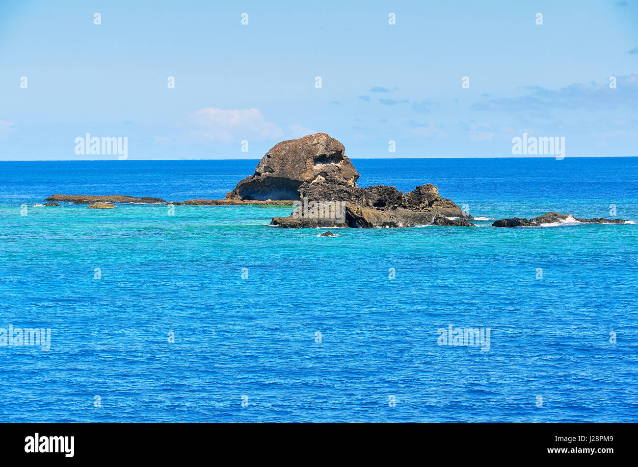Colorful ocean near the tropical Waya Lailai Island in Fiji - Stock Image