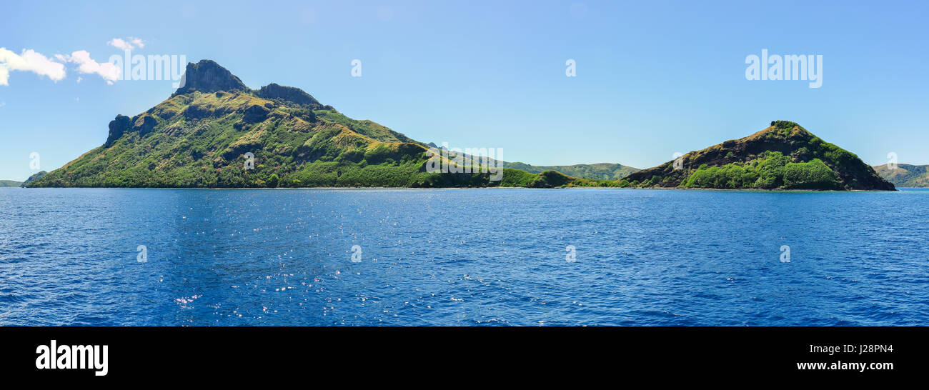 Passing near the tropical Waya Lailai Island in Fiji - Stock Image