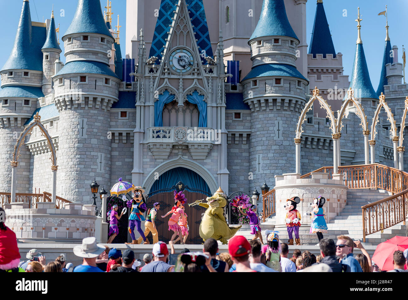Crowd watching performance in front of Magic Kingdom Castle, Disney World. - Stock Image