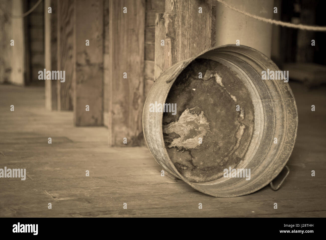 Old washtub in a warehouse - Stock Image