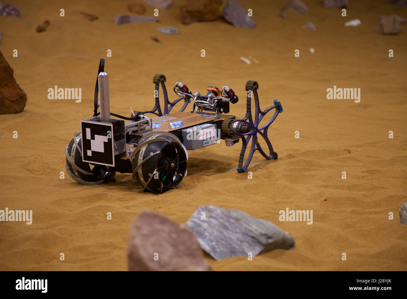A small scout prototypes for the ESA ExoMars rover mission to Mars is tested by Airbus in a warehouse made to look - Stock Image