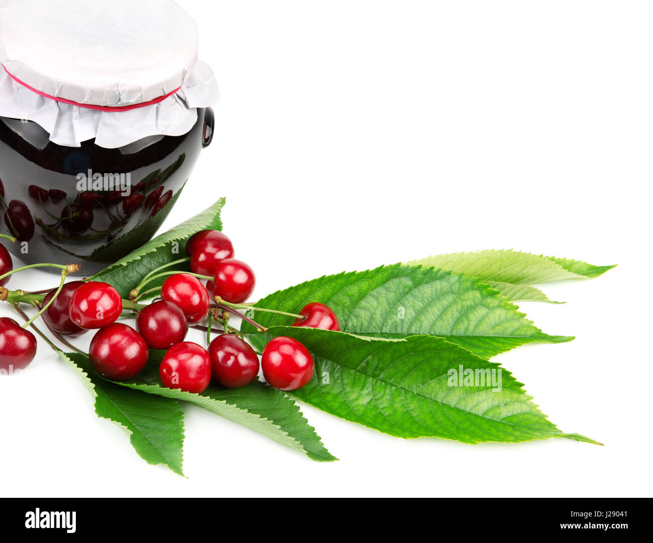 Cherry jam and cherries isolated on white background - Stock Image