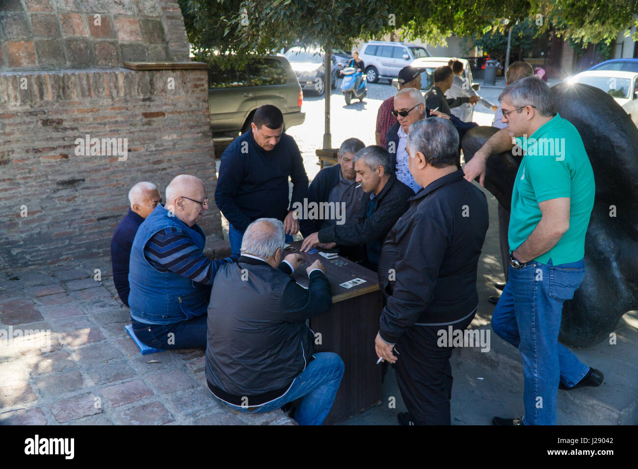 TBILISI, GEORGIA-SEP 25, 2016: Georgian men playing cards for money in the centre of old town. Stock Photo
