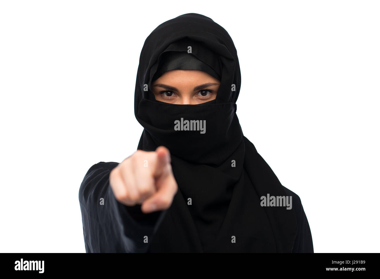 muslim woman in hijab pointing finger to you - Stock Image