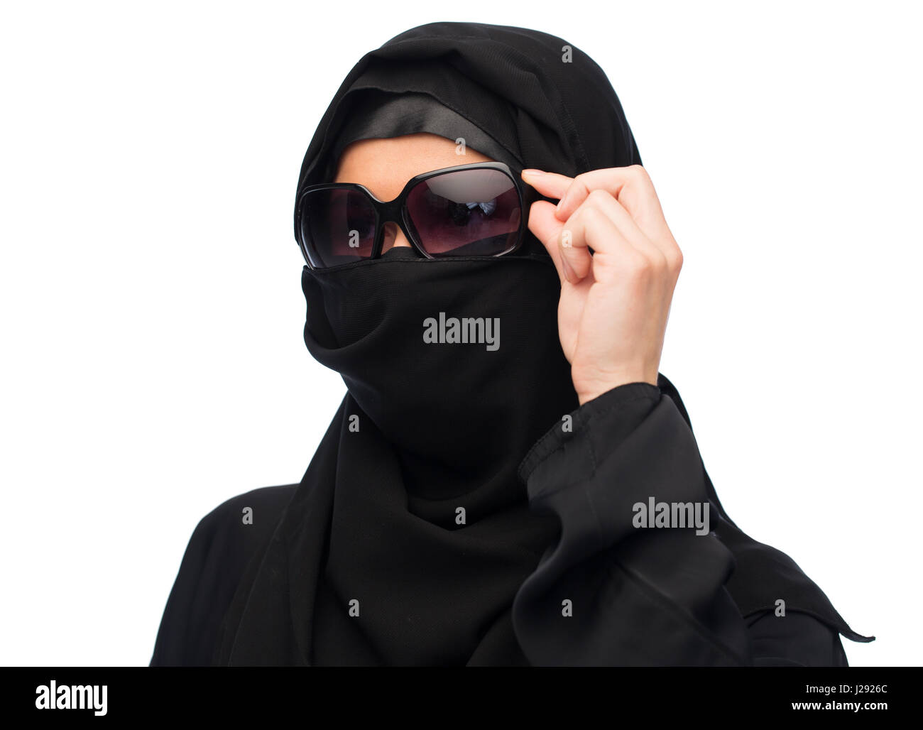 muslim woman in hijab and sunglasses over white - Stock Image