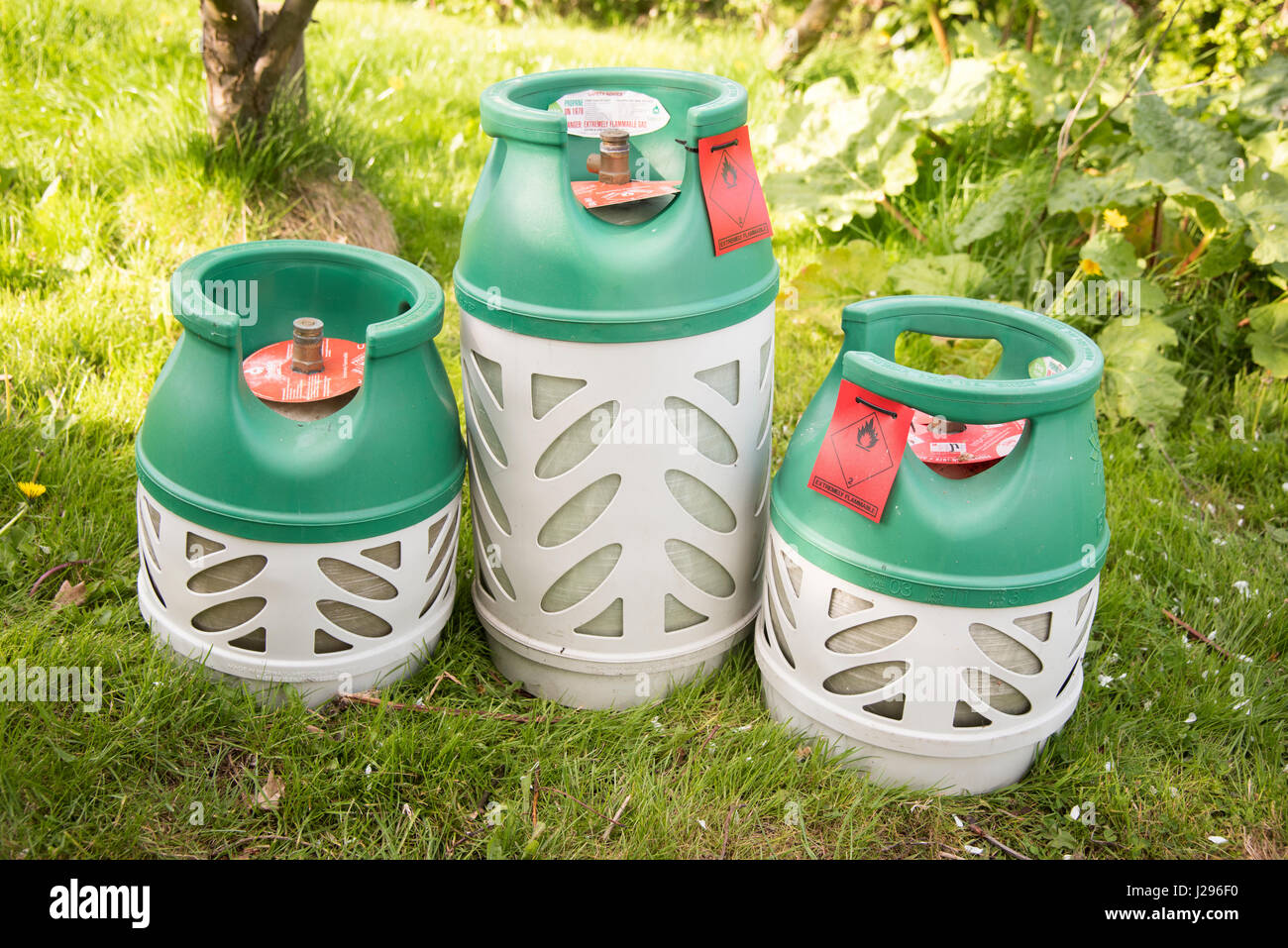 THree bottles of BP gaslite a lightweight butane gas cylinder for caravanning camping abd BBq's - Stock Image