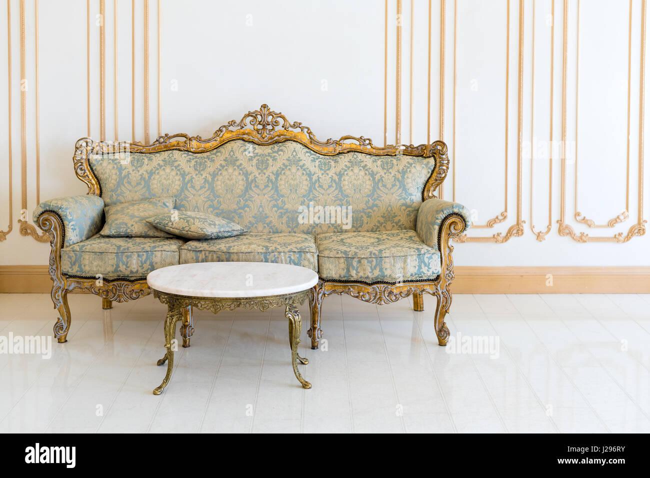 Luxury livingroom in light colors with golden furniture details ...