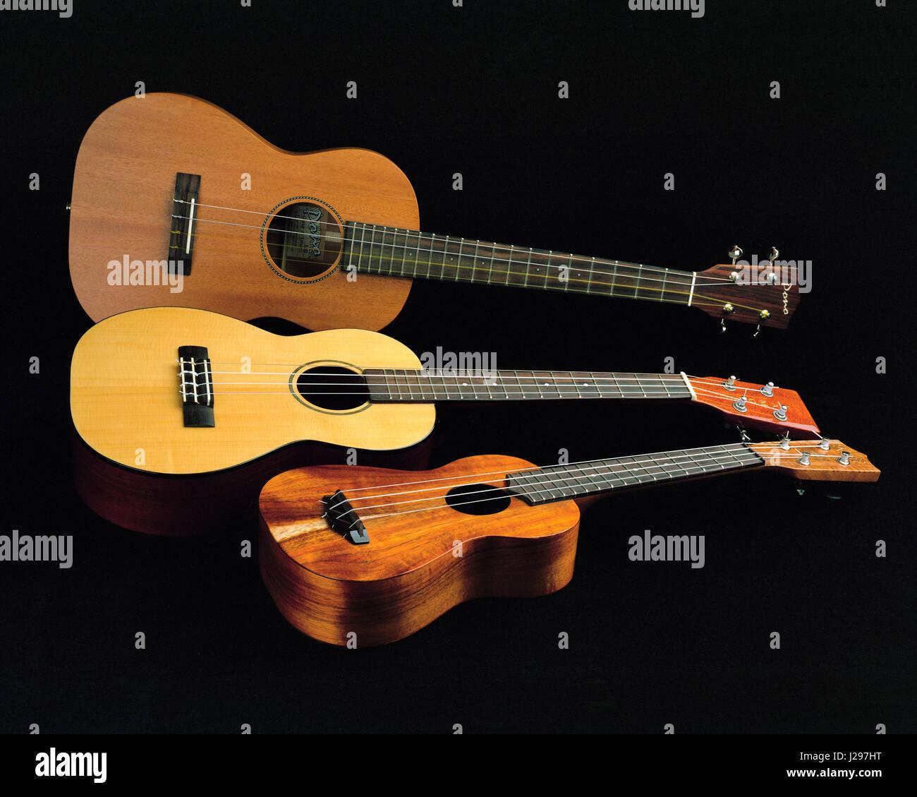 Trio of soprano, tenor and baritone ukuleles - Stock Image