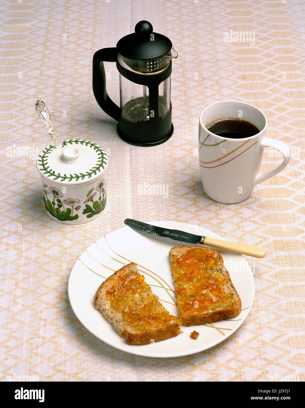 Breakfast table with coffee and toast and marmalade - Stock Image