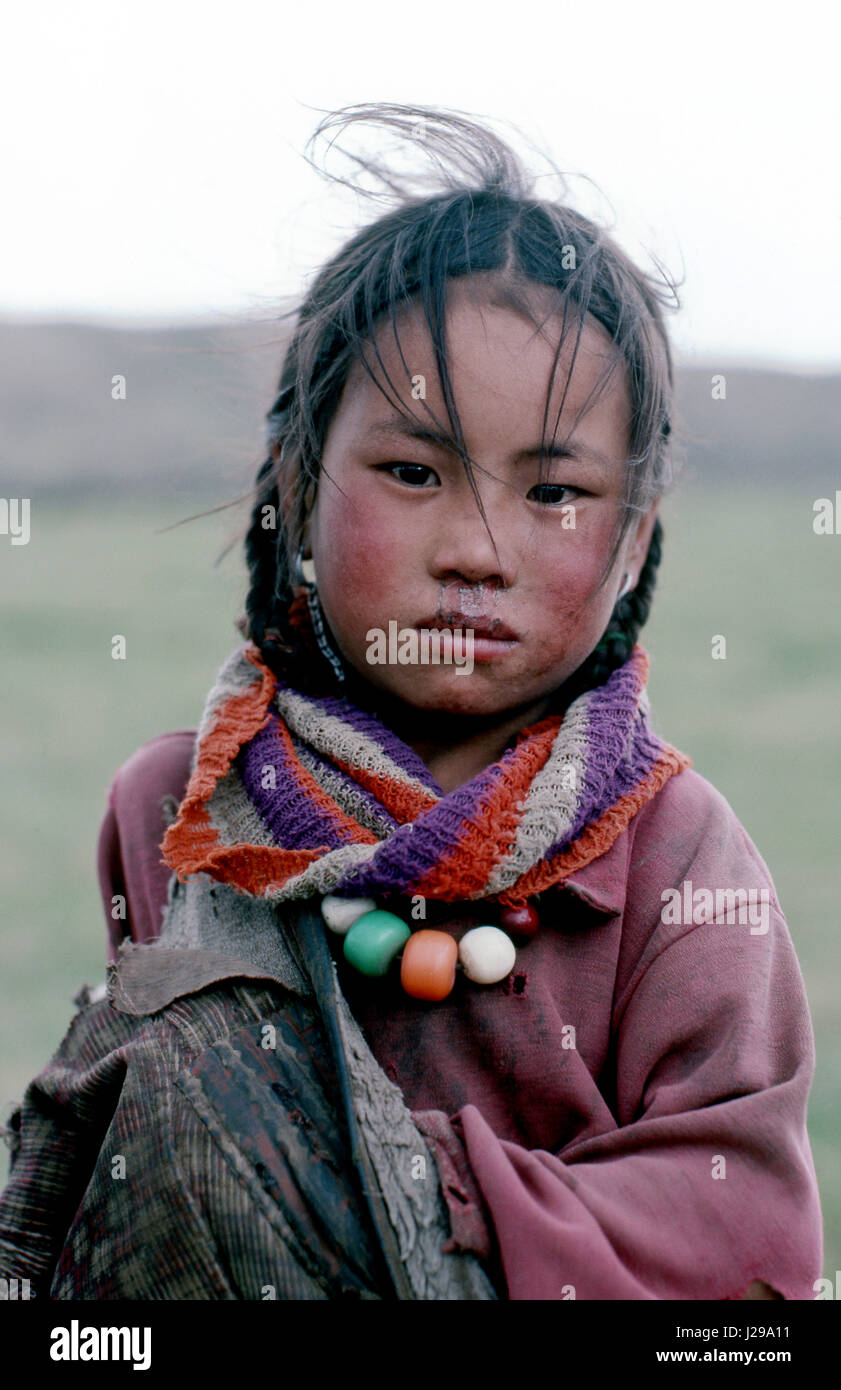 Portrait of a young girl from the Grasslands area of Tibet, China - Stock Image