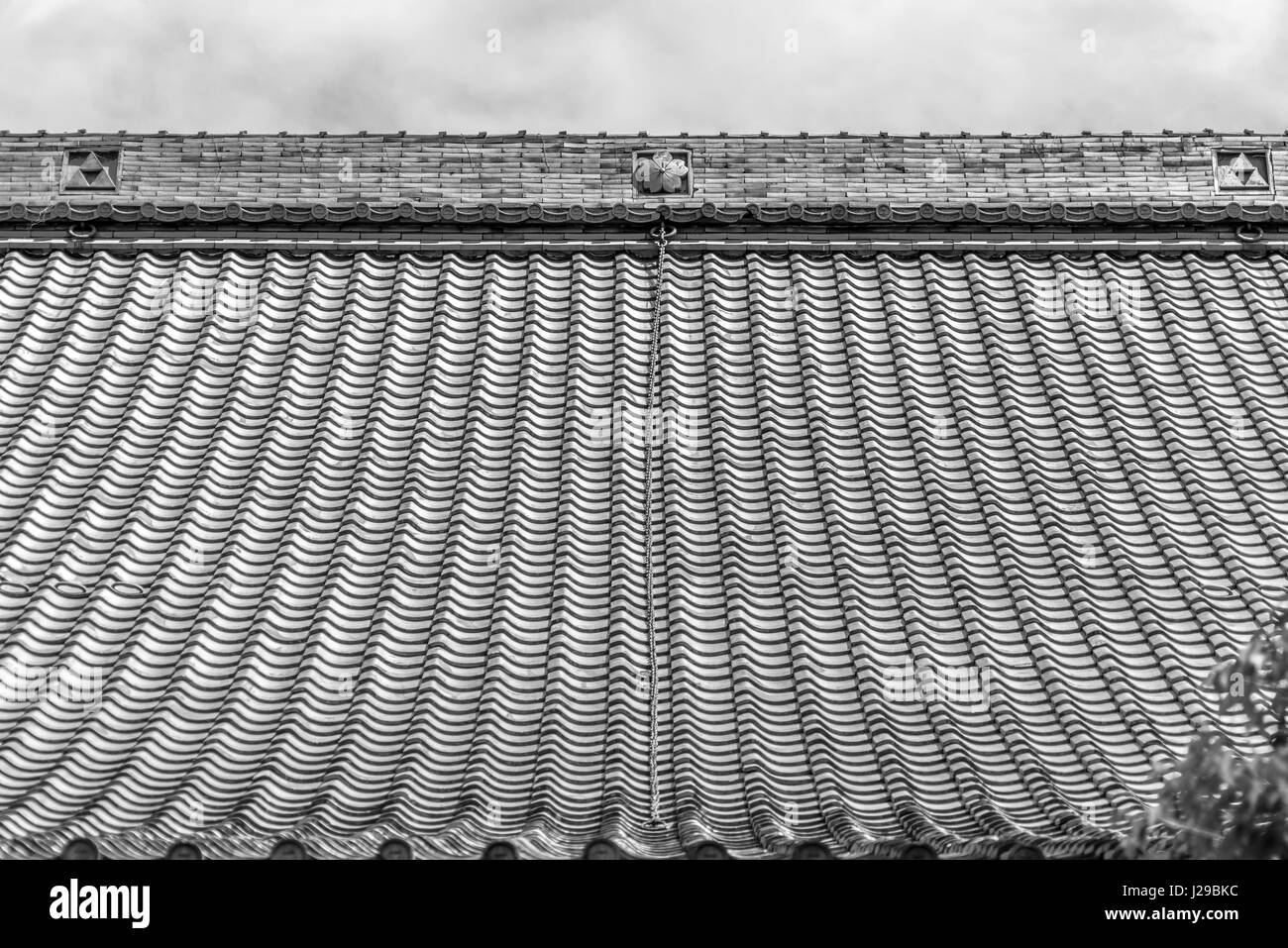 Traditional roof of Hokaiji Temple, also called Hagidera or 'bush-clover temple' Built in 1237. Located - Stock Image