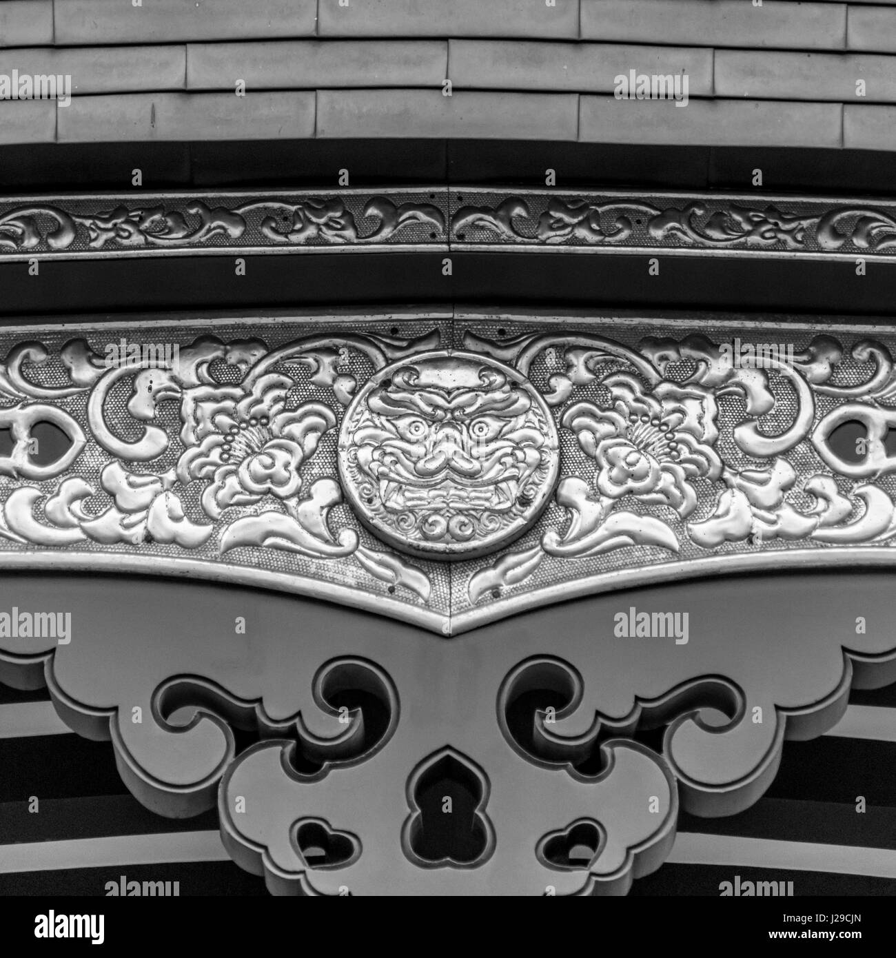 Detail of the beautiful Oni icon and ornaments in the roof of Haneda Shrine (Haneda Jinja). Located in Ota Ward, - Stock Image
