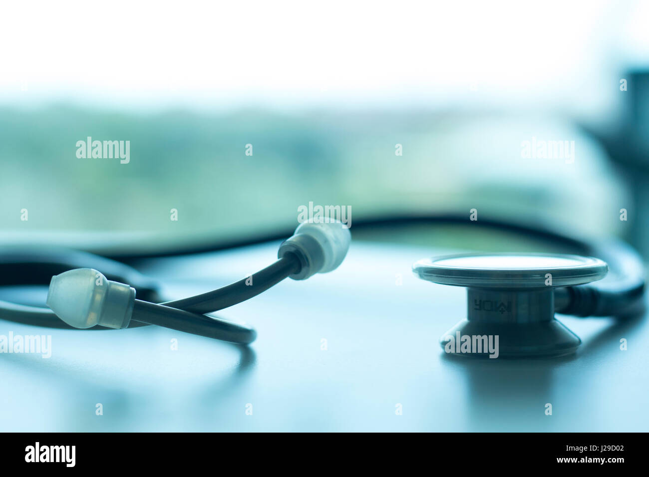 Doctors medical stethoscope heart rate monitoring equipment to listen to heartbeats of patient, - Stock Image