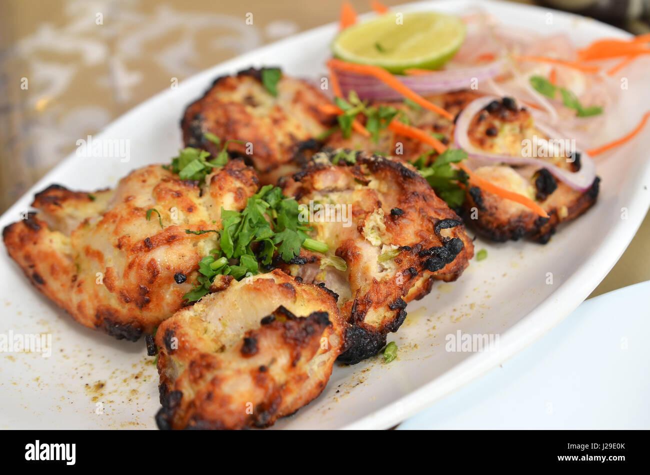 Chicken Malai Tikka Boneless piece, Indian dish. Stock Photo