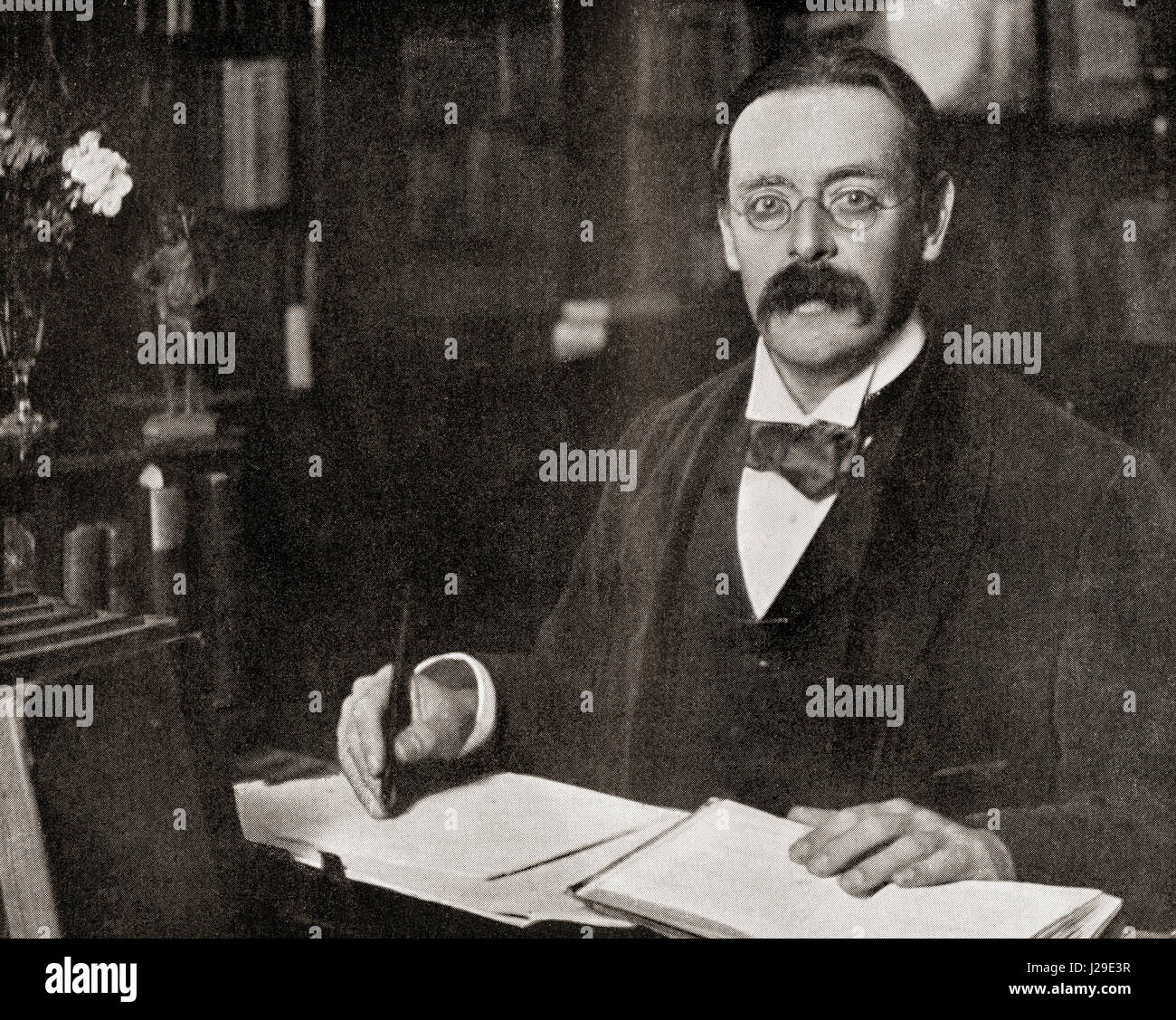 Sir Edmund William Gosse, 1849 –  1928, seen here in his library.  English poet, author and critic.  From The International - Stock Image