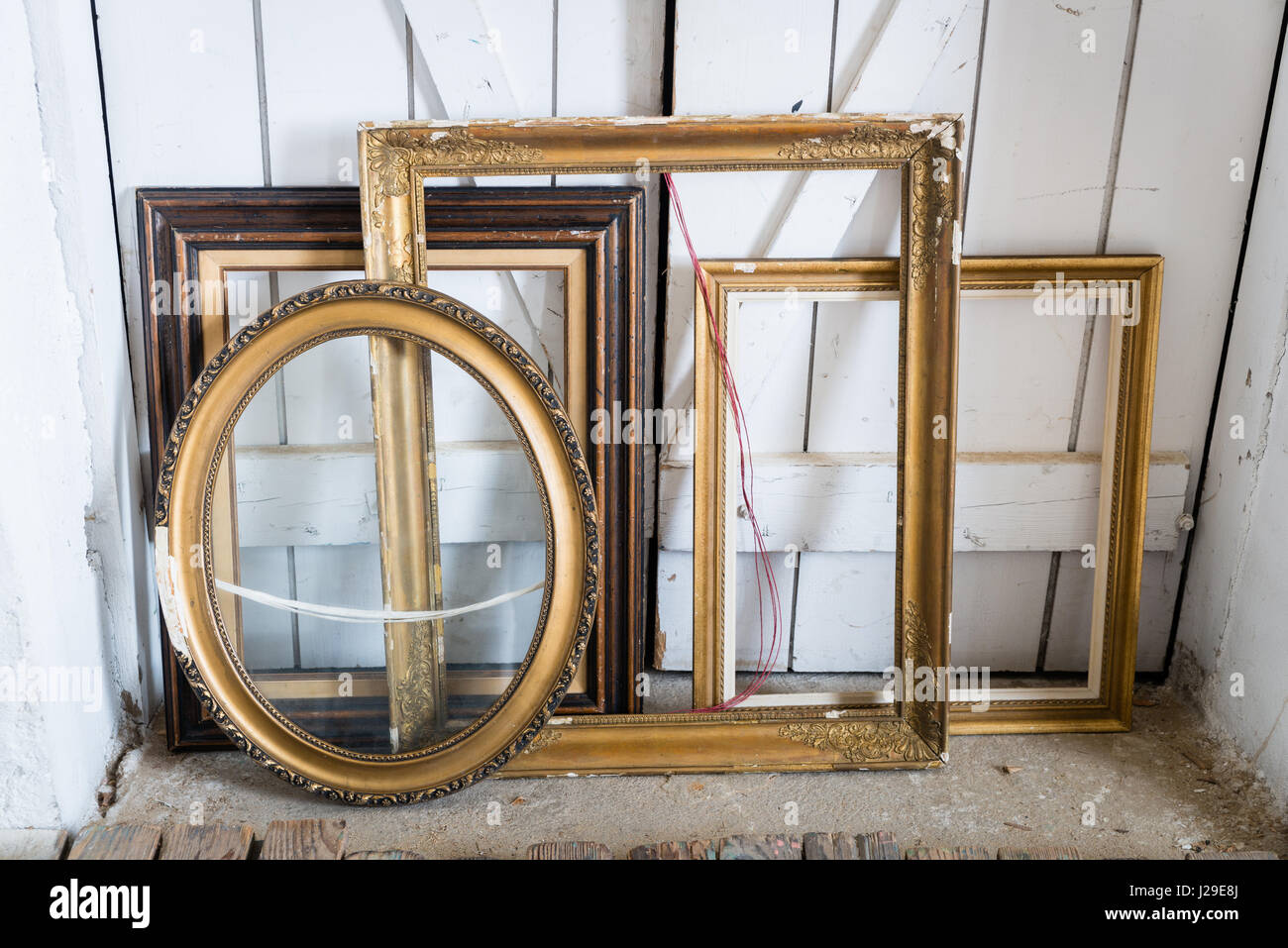 Old wooden painting frames on the floor Stock Photo: 139121042 - Alamy