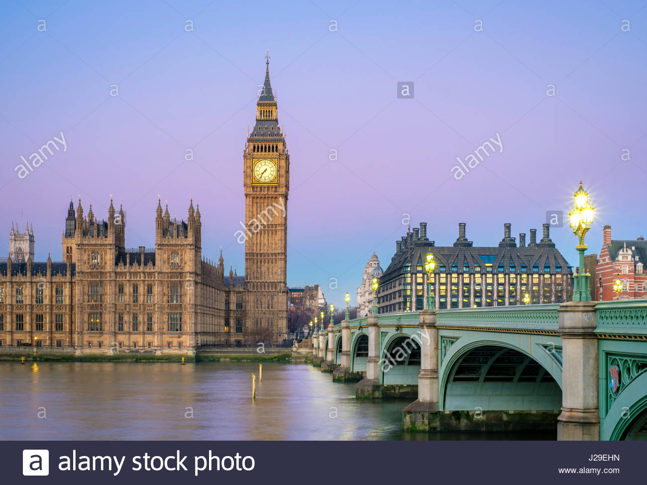United Kingdom, England, London. Westminster Bridge, Palace of Westminster and the clock tower of Big Ben (Elizabeth Tower), at dawn. Stock Photo