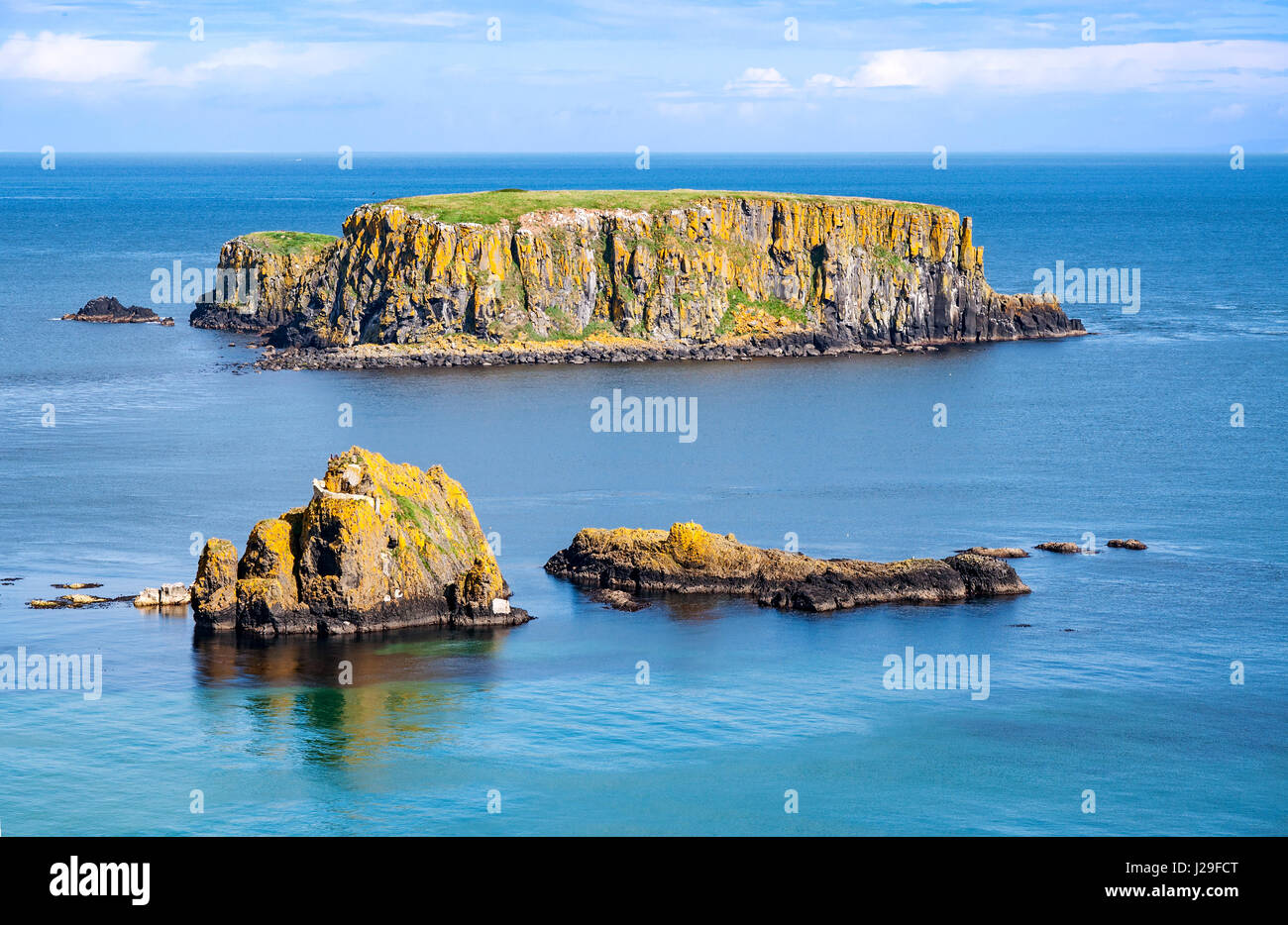 The Sheep Island and two smaller ones near Ballintoy, Carrick-a-Rede and Giant's Causeway, North Antrim Coast, - Stock Image