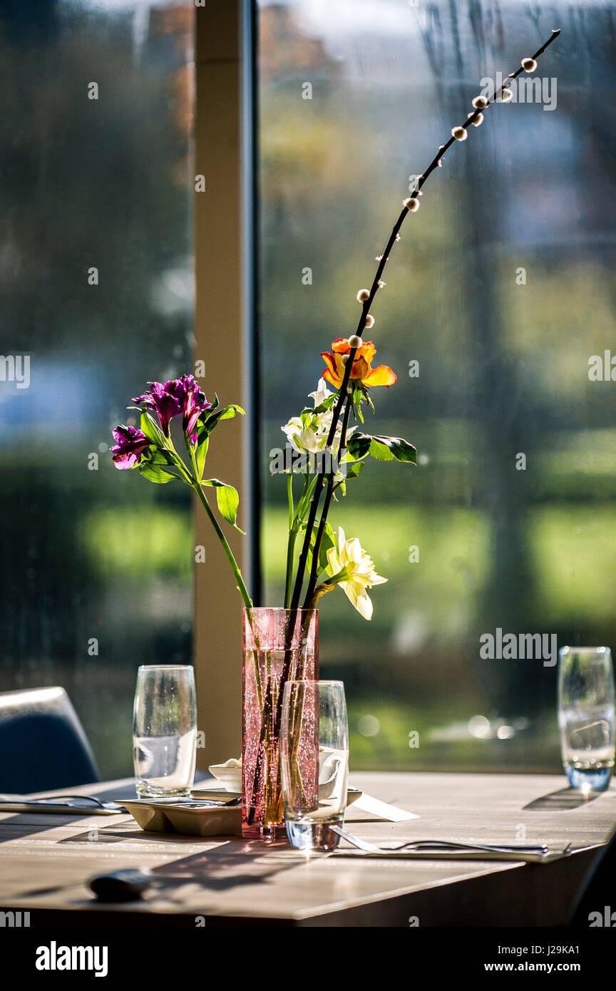 Restaurant Interior Flowers Blooms Vase Arrangement Table Colourful Colorful - Stock Image