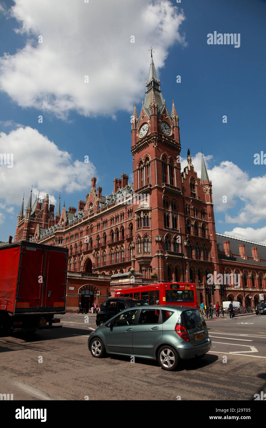 The clock tower of the St. Pancras Renaissance London Hotel, as seen from Euston Road opposite King's Cross station - Stock Image