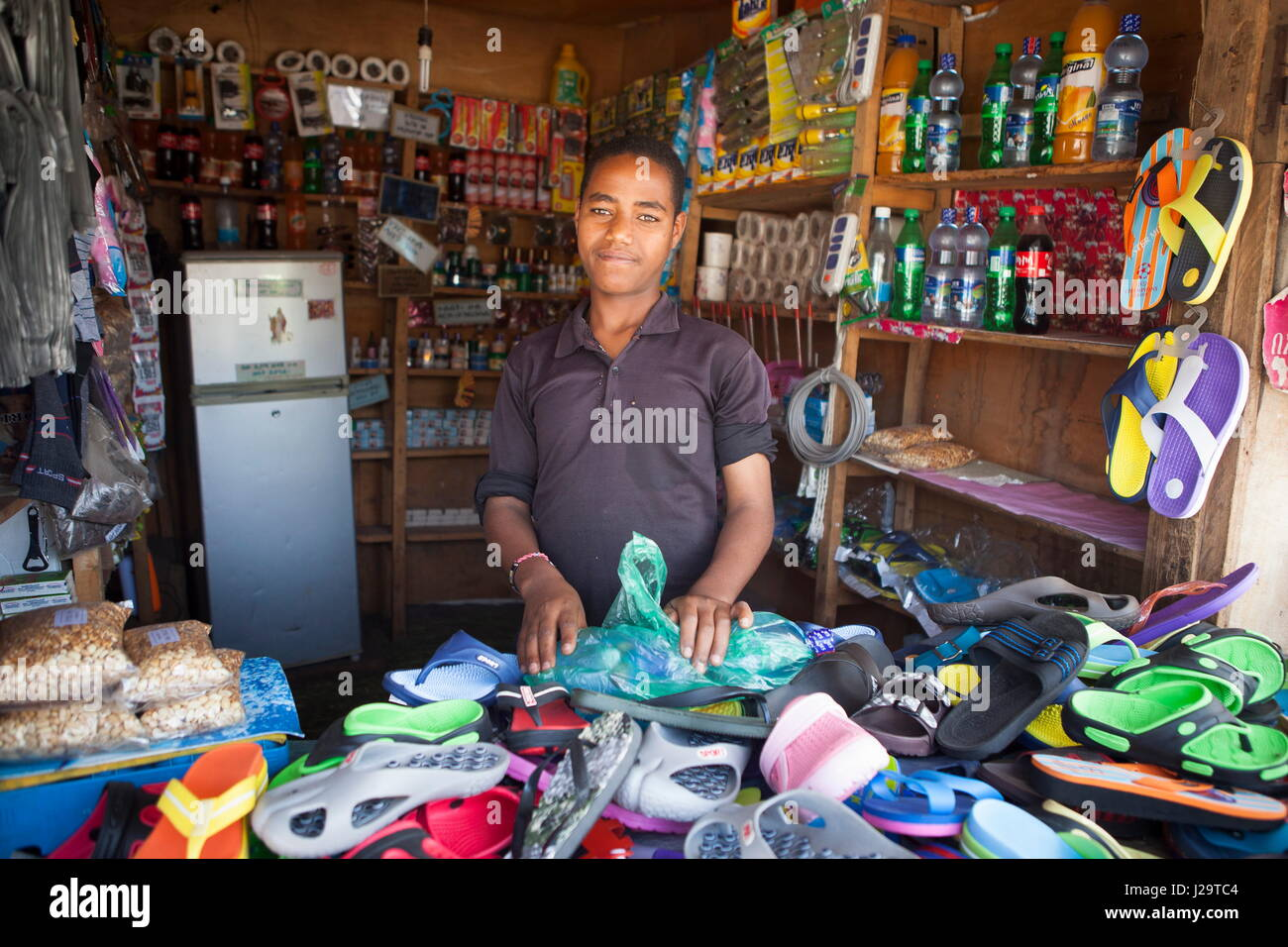 Ethiopia, Awassa, Portrait of a 20-year-old man in a grocery shop - Stock Image
