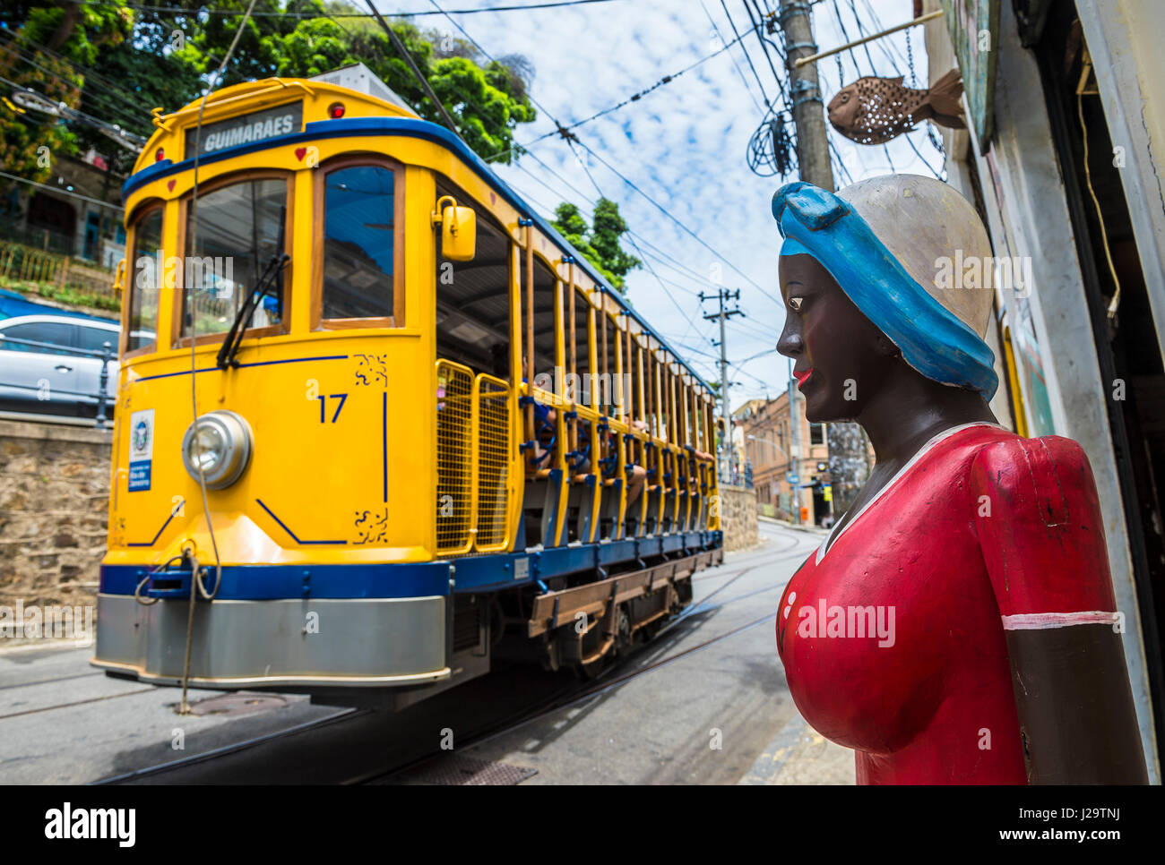 RIO DE JANEIRO - JANUARY 31, 2017: A brightly painted statue of a Brazilian woman stands on the street as a traditional - Stock Image