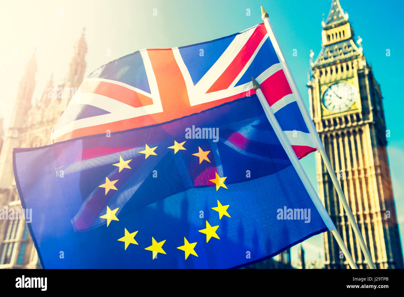 UK and EU European Union flags flying together in bright sun in front of the Houses of Parliament at Westminster - Stock Image