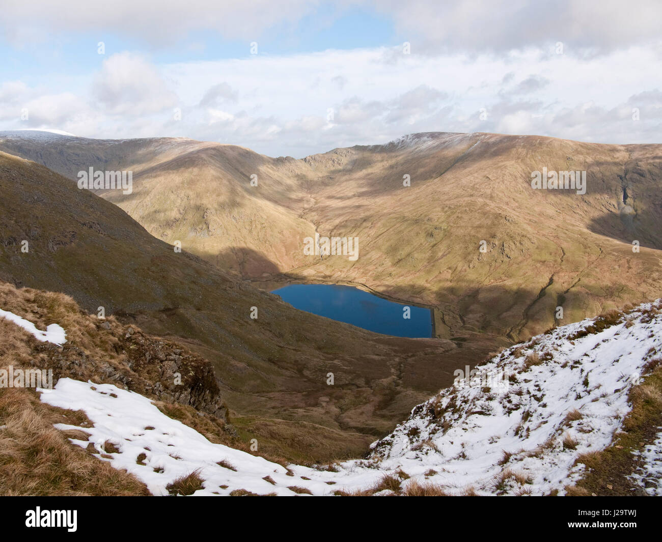 View from Yoke across Kentmere reservoir and Kentmere Common to the Nan Bield Pass, between Mardale Ill Bell (L) - Stock Image