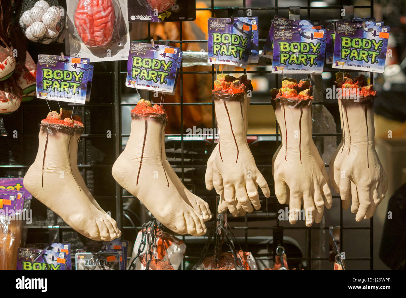 Hand and foot body parts for sale at the Halloween Adventure in Greenwich Village, Manhattan, New York City - Stock Image