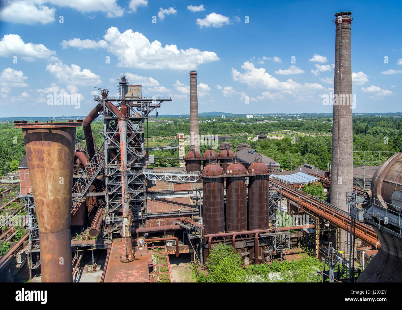 old-industrial-buildings-and-chimneys-of-abandoned-steel-mill-plant-J29XEY.jpg