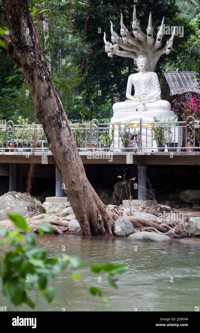 Buddha Overlooking Hin Lad waterfalls in Ko Samui, Thailand - Stock Image
