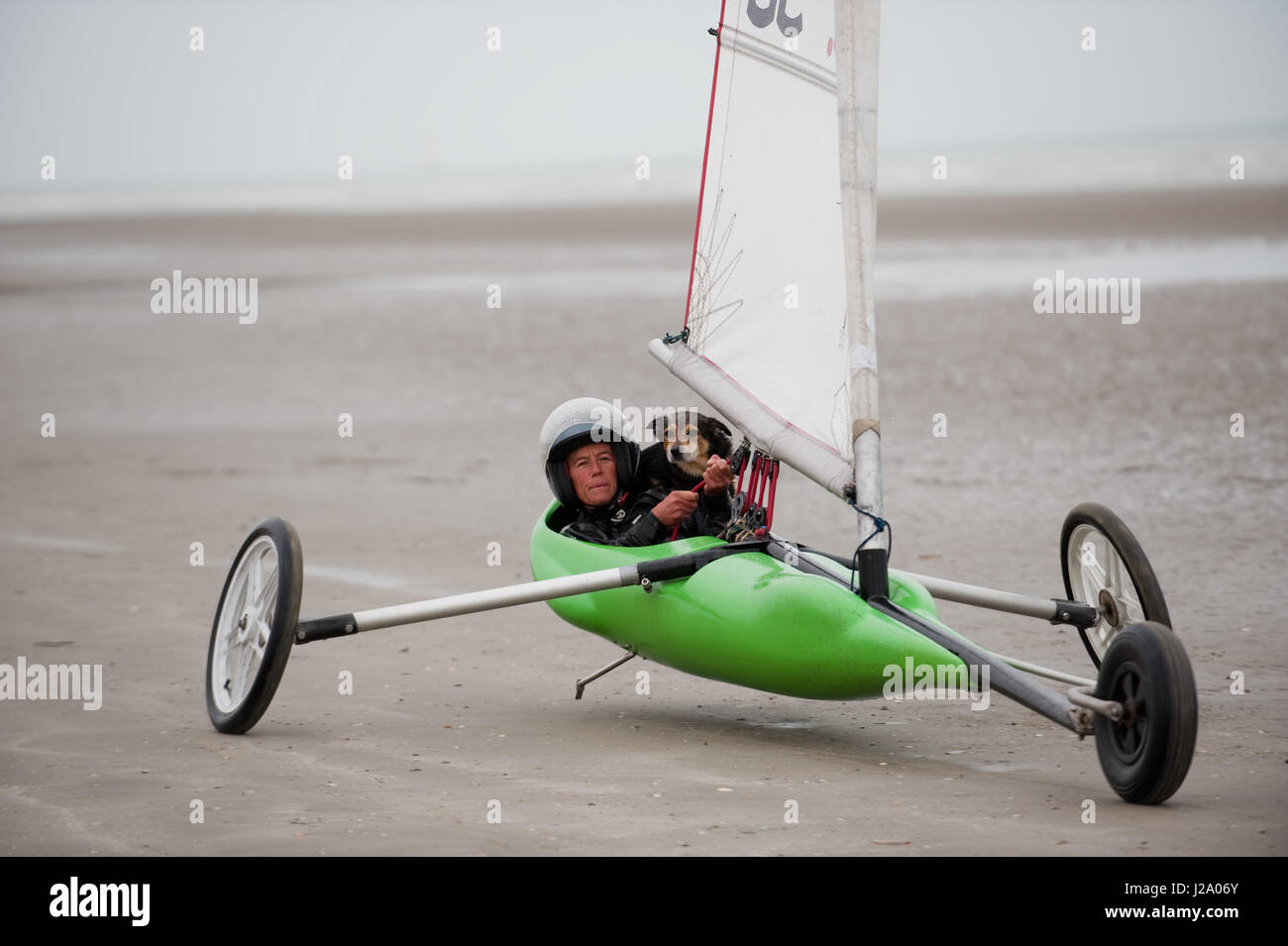 Land sailing, also known as sand yachting or land yachting, is the act of moving across land in a wheeled vehicle - Stock Image