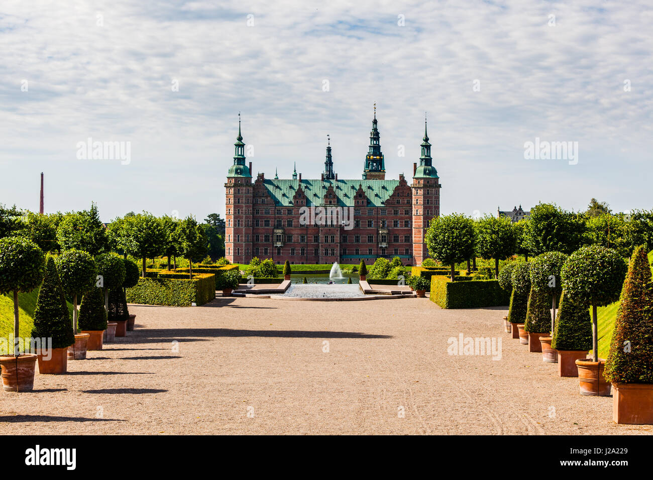 The majestic castle Frederiksborg Castle seen from the beautiful park area, - Stock Image