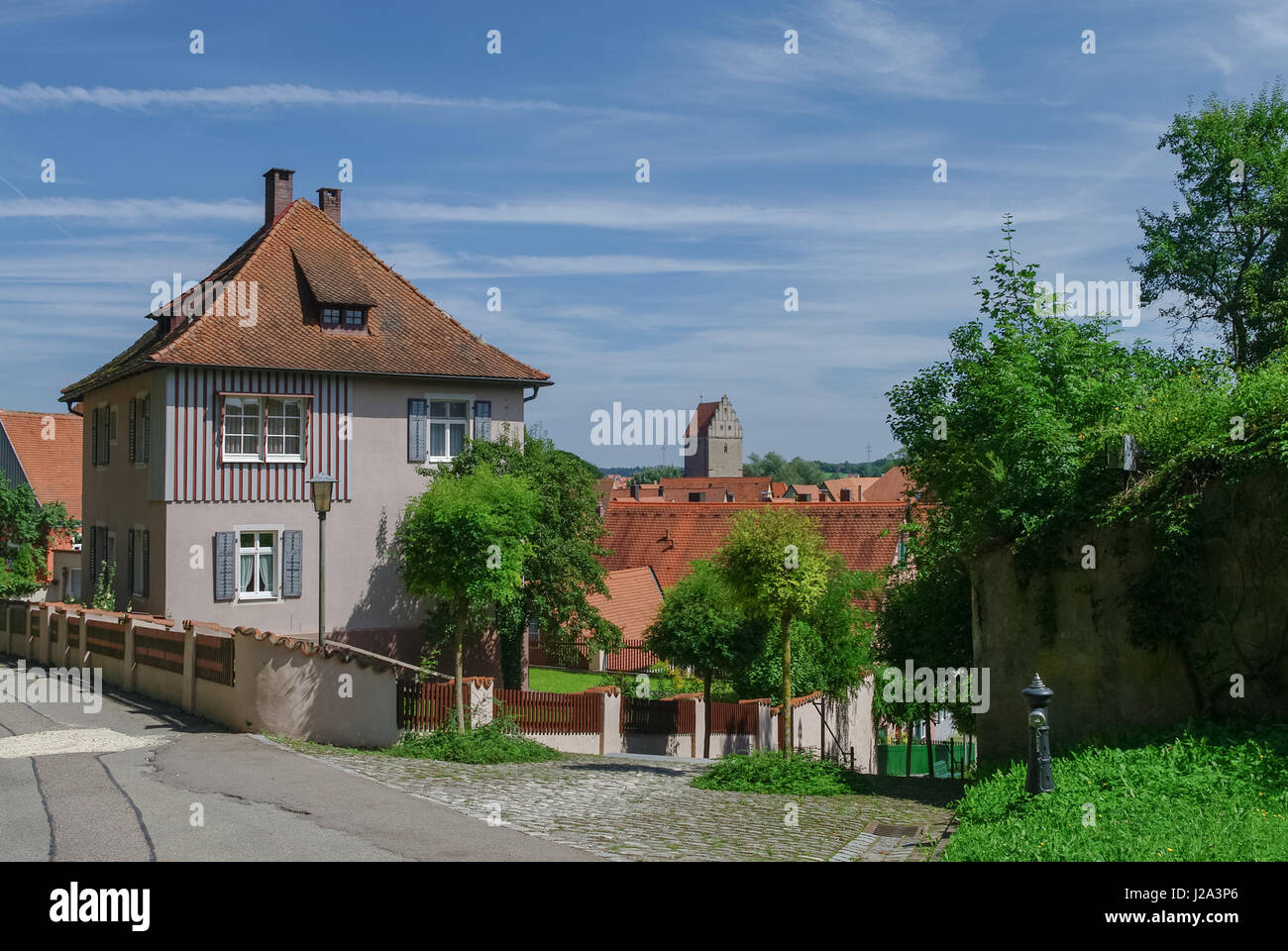 Street view of Dinkelsbuhl, one of the archetypal medieval towns on the German Romantic Road. Germany - Stock Image