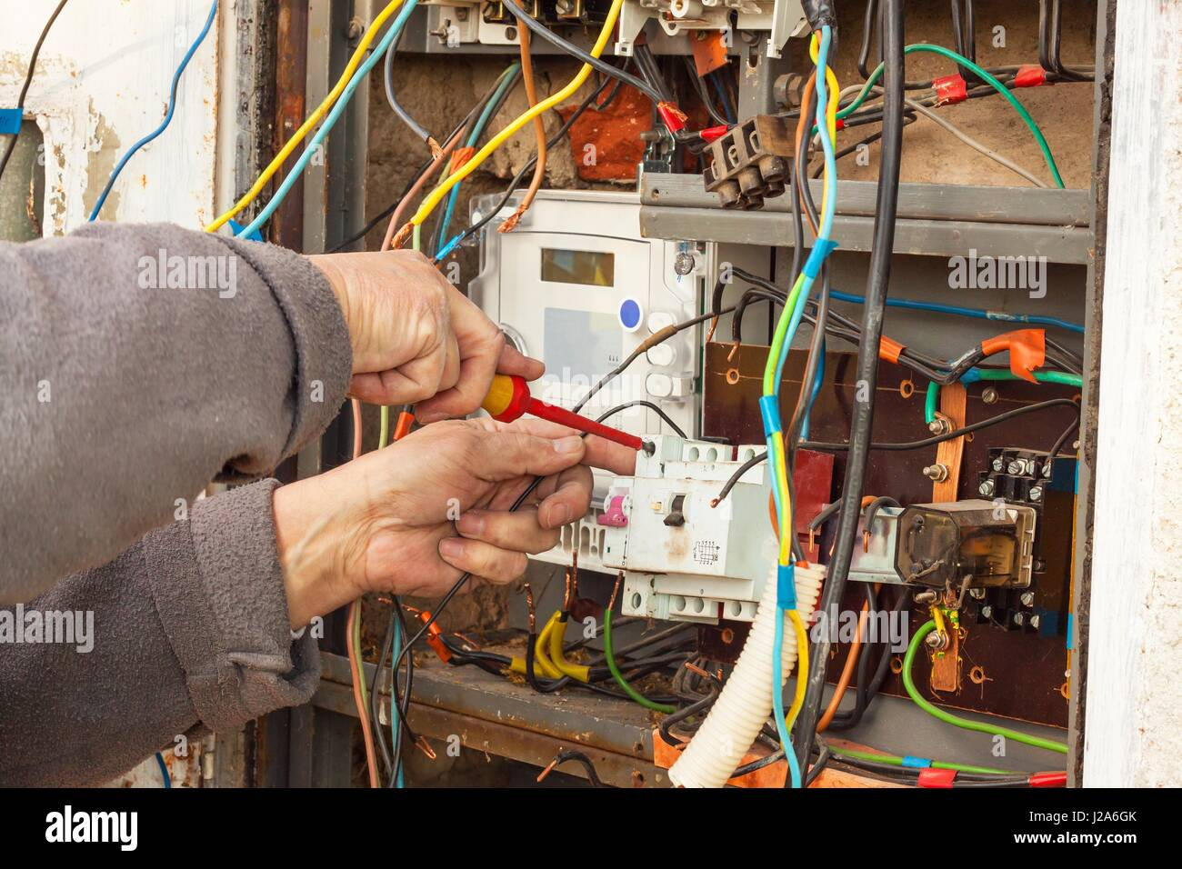repair of electricity distribution in an old house the man repairs rh alamy com body electrical wiring repaired electrical wiring repair cost