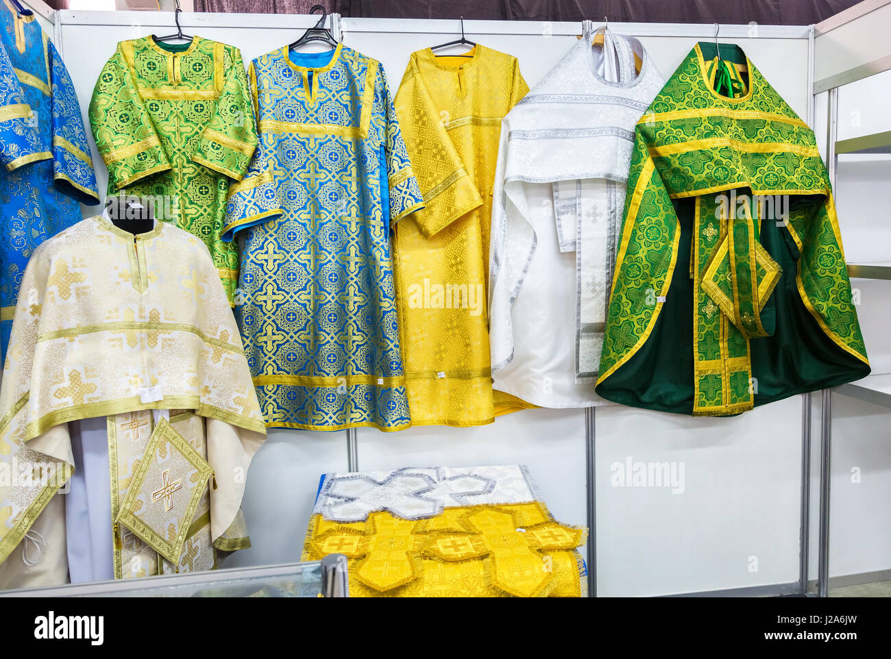 Different solemn slavic orthodox priest's robes - Stock Image