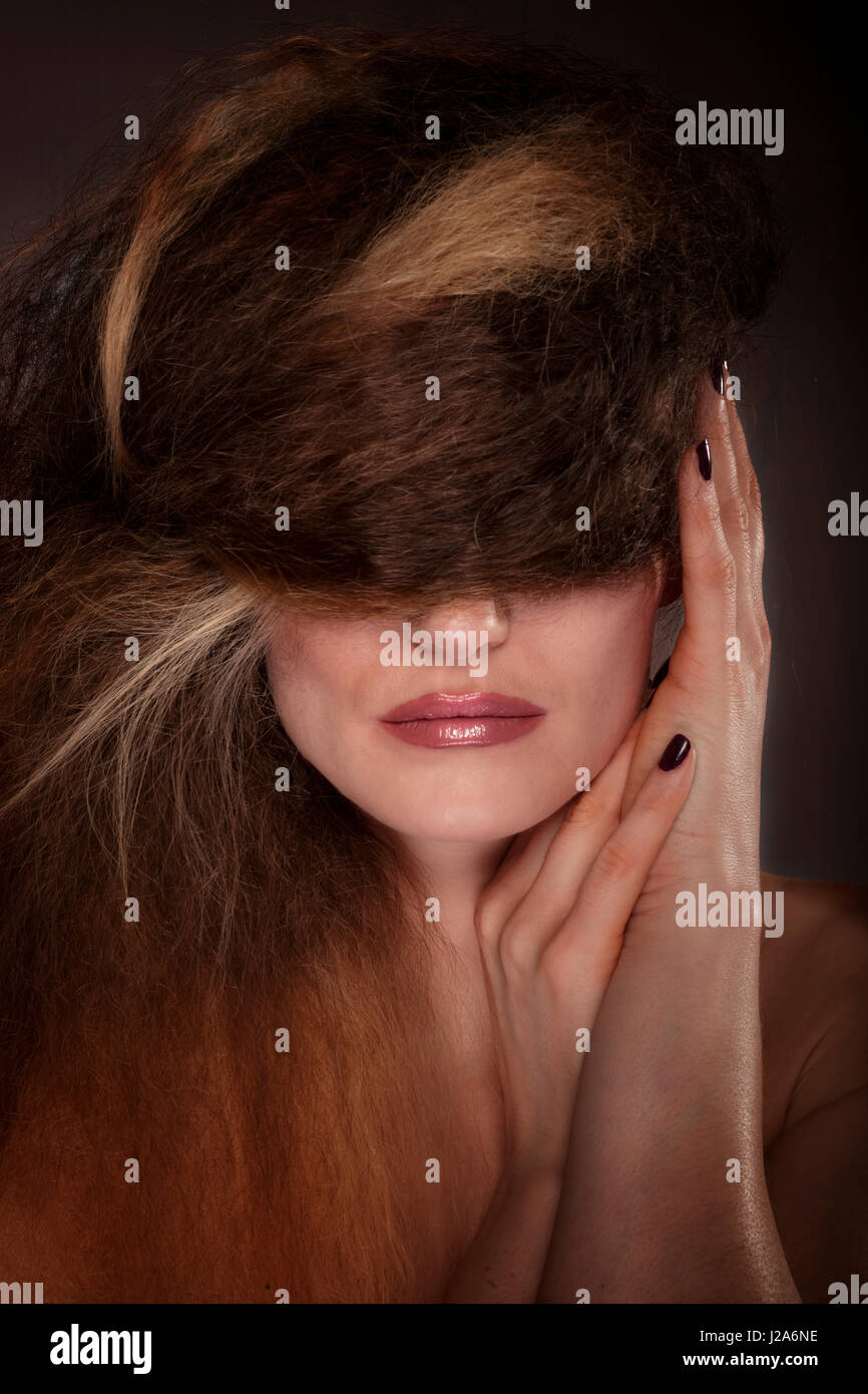 half face covered with hair Stock Photo