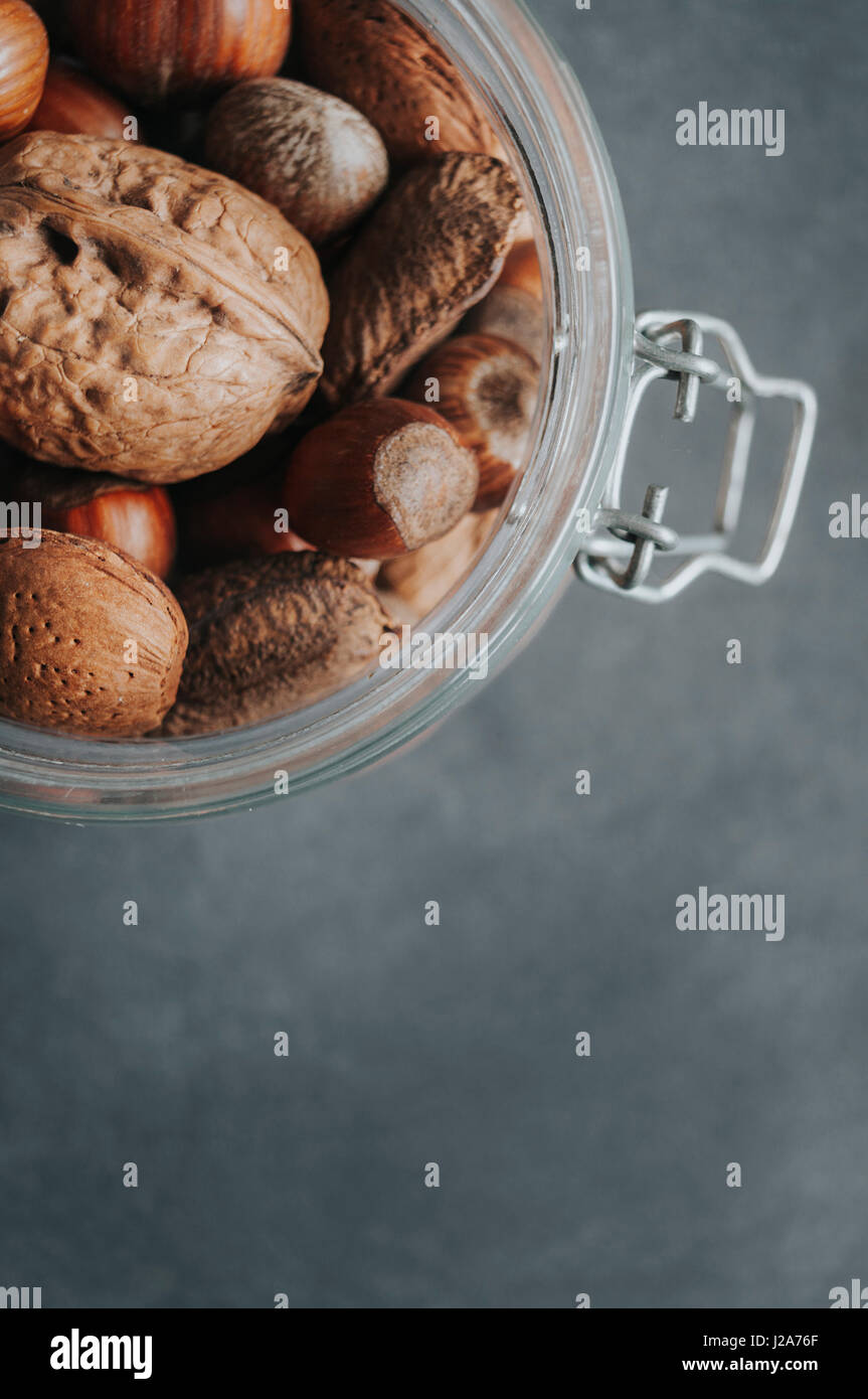 Mixed Nuts on a Dark Background. With copy space. - Stock Image